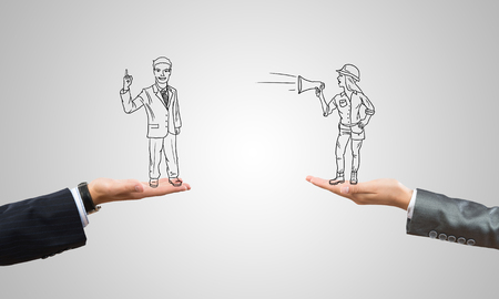 agressive: Drawn businesspeople in human palms on gray background Stock Photo