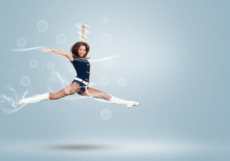 Young beautiful smiling cheerleader girl jumping high Stock Photo