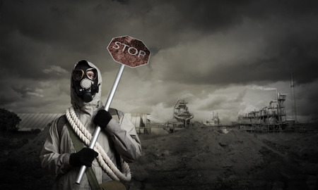 stalker: Stalker in gas mask with precaution stop signboard