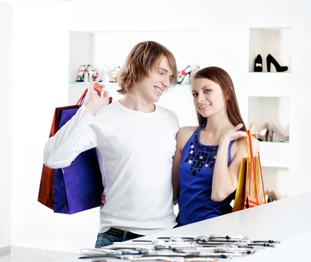 cute man and the woman in shop choose clothes photo