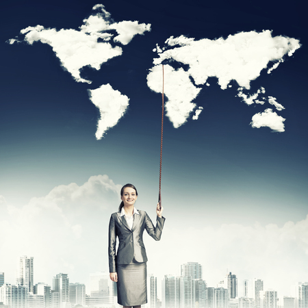businesswoman suit: Businesswoman in suit holding world map on lead