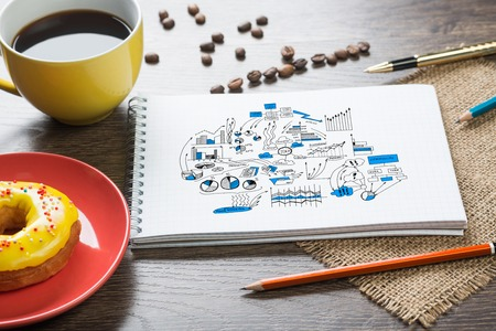 school strategy: Top view of workplace with notepad for ideas and cup of coffee