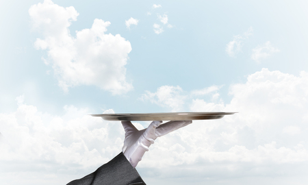 white glove: Butler hand in white glove presenting empty tray