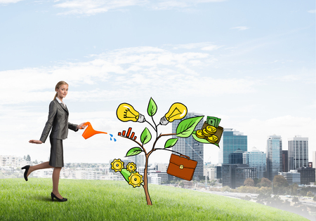 Attractive businesswoman presenting investment and financial growth concept Stock Photo