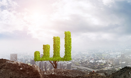 smart investing: Market growth and success as growing green tree in shape of graph Stock Photo