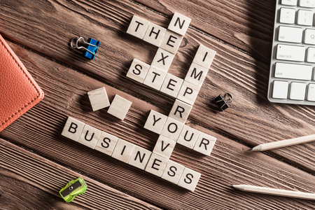 vision loss: Words of business marketing collected in crossword with wooden cubes