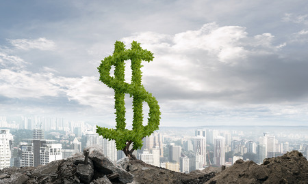 Market growth and success as growing green tree in shape of dollar Stock Photo