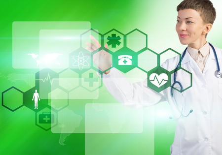 Young female doctor touching icon of media screen