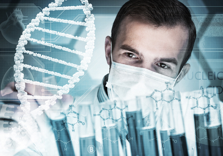 concentrated: Portrait of concentrated male scientist working with reagents in laboratory