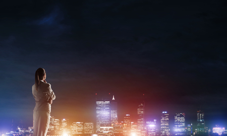 night vision: Woman looking at night city