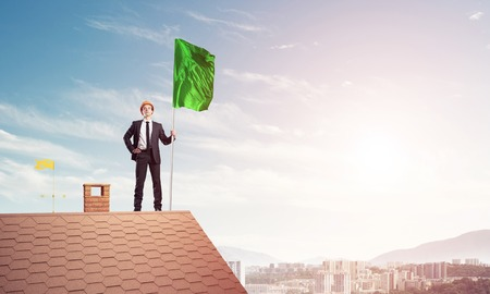 mi: Young businessman with flag presenting concept of leadership. Mi Stock Photo