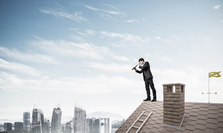mister: Mister boss on brick roof in search of something new. Mixed medi Stock Photo