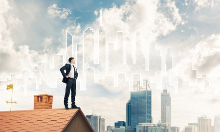mister: Mister boss on brick roof with arms akimbo. Mixed media Stock Photo