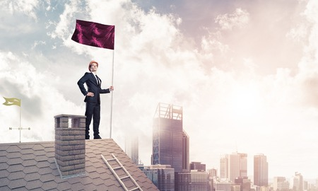real leader: Young businessman with flag presenting concept of leadership. Mi Stock Photo