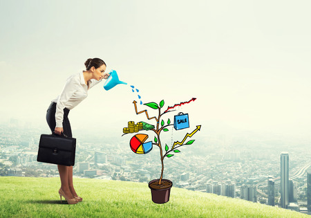 Young businesswoman outdoors watering drawn growth concept with can