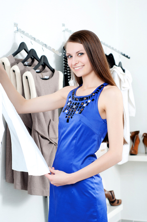 young Beautiful woman in mall buying clothes photo