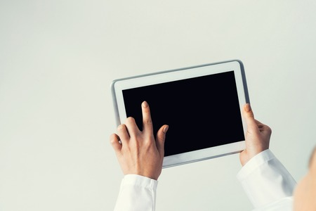 blank tablet: Tablet pc device with blank screen in hands of doctor