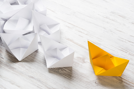 Set of origami boats on wooden table Stock Photo