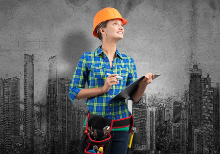 architect drawing: Engineer woman with folder and sketches of construction project on wall