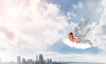 Young woman flying high in blue sky