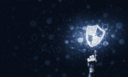 Person touching shield glowing icon as concept about security and protection Stockfoto