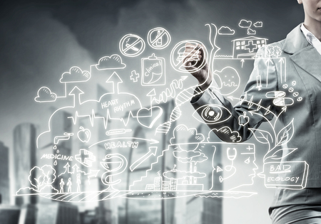 Close view of businesswoman drawing ecology concept on screen Stock Photo