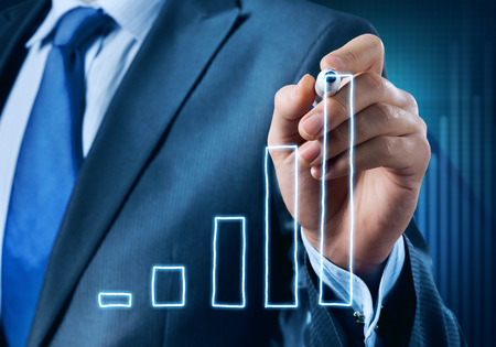 average guy: Close view of businessman drawing on screen growing graph