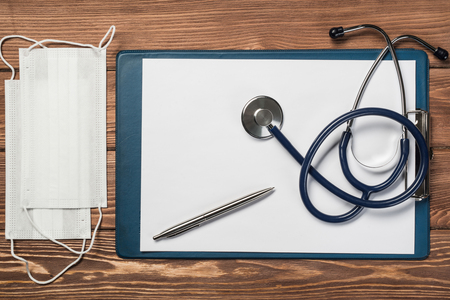 stuff: Doctors wooden table with tablet stethoscope and other stuff