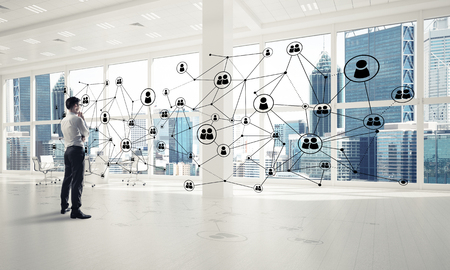 Elegant businessman in 3D office interior and social connection concept. Mixed media