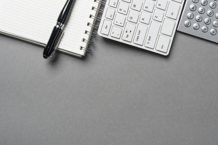 Concept of business still life with office objects on gray surface Stock Photo