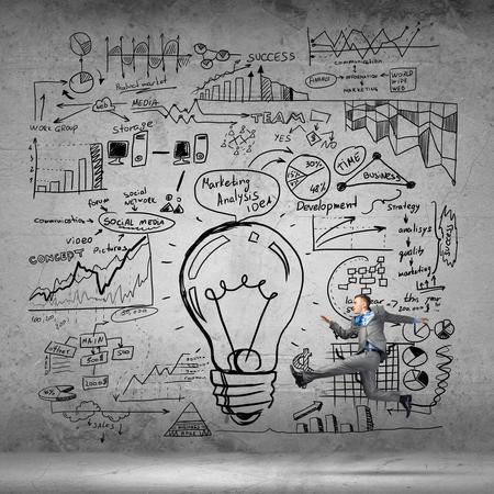 Running businessman on background of business plan sketches Stok Fotoğraf