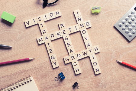 keyword: Words of business marketing collected in crossword with wooden cubes
