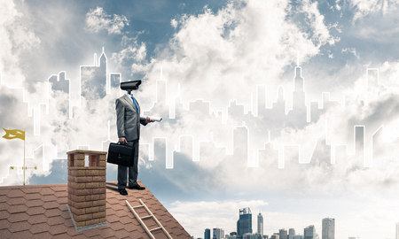 skill: Faceless businessman with camera zoom instead of head standing on house roof