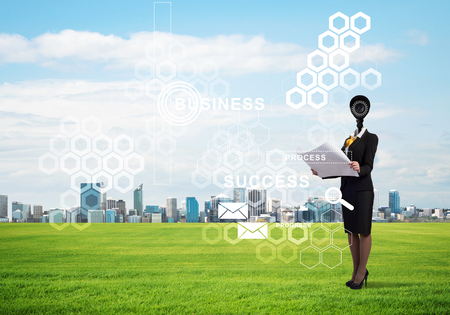 Elegant businesswoman outdoors with camera instead of head and media interface on screen Stock Photo