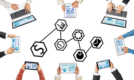 earn money: Group of people with devices in hands working together as symbol of networking and communication Stock Photo