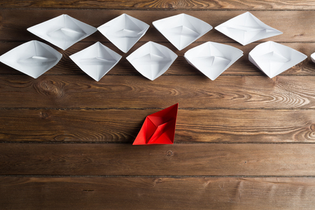 Set of origami boats on wooden table Stock fotó