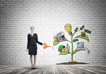 Attractive businesswoman presenting investment and financial growth concept Reklamní fotografie