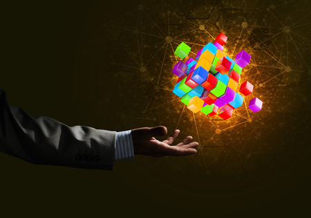 technology symbols metaphors: Close of businessman hand holding cube figure as symbol of innovation. 3D rendering Stock Photo