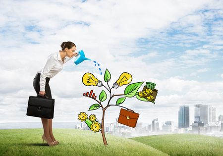 Attractive businesswoman presenting investment and financial growth concept Stok Fotoğraf