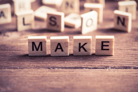 Make it real phrase collected of wooden elements with the letters