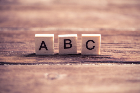 Alphabet letters on wooden pieces collected in word abc Stock Photo