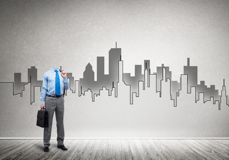 architect: Headless engineer man with case in hand against construction background Stock Photo