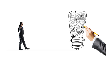 Young businessman walking forward to idea on drawn line Stock Photo
