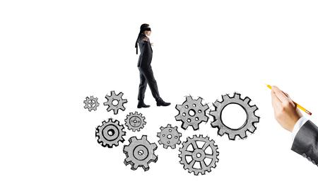 Young businessman walking forward on drawn gears mechanism Stock Photo