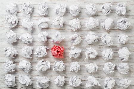 Set of crumpled paper balls with one colorful Reklamní fotografie