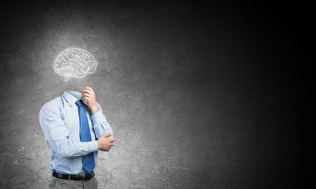 careerist: Faceless businessman with drawn brain instead of head
