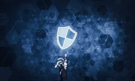 Person touching shield glowing icon as concept about security and protection Stock Photo