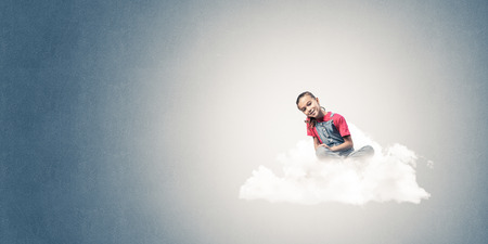 become: Cute kid girl sitting on cloud against blue color background