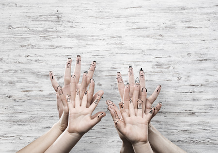 Close view of child and parents hands as symbol of happy family