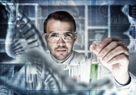 researching: Handsome scientist making research over dna molecule structure
